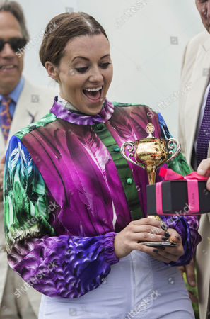 Camilla Henderson, daughter of trainer Nicky, with the Magnolia Cup after winning the Ladies Charity Race at Goodwood