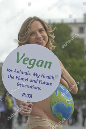 TV presenter Sarah-Jane Honeywell poses as mother earth in Trafalgar Square for PETA painting her pregnant body to highlight Vegan for Animals, My Health, the Planet and Future Generations