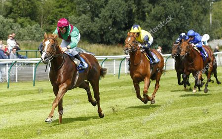 Dream Mover and Neil Callan win the Breeders Backing Racing EBF Maiden Stakes at Nottingham from Waslawi.