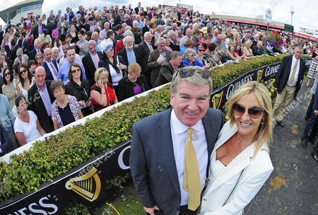 Stock Image of Galway. Owner JOHN BRESLIN and wife DEBBIE after QUICK JACK and Denis O'Regan won The Guinness Galway Hurdle for trainer Tony Martin.