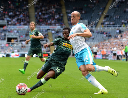 Ibrahima Traore of Borussia Monchengladbach (left) challenges Gabriel Obertan of Newcastle United for the ball