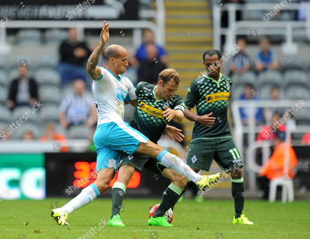 Gabriel Obertan of Newcastle United (left) challenges Tony Jantschke of Borussia Monchengladbach