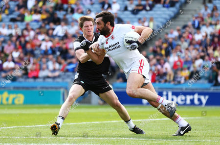 Sligo's David Kelly tackles Joe McMahon of Tyrone