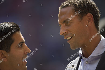 BBC Sport presenter Manish Bhasin talks to Rio Ferdinand, working for BT Sport, during the FA Community Shield played at Wembley Stadium