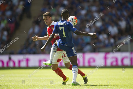 Mesut Ozil of Arsenal is caught in thr ribs by Ramires of Chelsea during the FA Community Shield played at Wembley Stadium