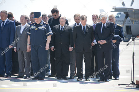Ukrainian Military Personal The Deputy Prime Minister Of Ukraine And Assembled Dignitaries Including The British Ambassador (simon Smith Front Row Second From Right Pictured During Minute Silence) Hold A Ceremony Of Respect At Kharkiv Airport In Ukraine For The First 40 Mh-17 Victims To Be Flown Home Aboard A Dutch Hercules C-130 To Holland Where They Will Be Forensically Examined Identified And Return To Their Families. See Rebecca Evans Story.