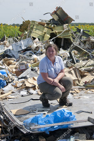 Abandoned And Unsecured With The Stench Of Death In The Air The Wreckage Of Flight Mh-17 Which Was Shot Down Over Ukraine 8 Days Ago. Journalist Rebecca Evans With The Cockpit Outside The Village Of Rassypnoe.