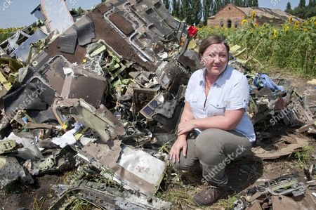 Ukraine: Abandoned And Unsecured With The Stench Of Death In The Air The Wreckage Of Flight Mh-17 Which Was Shot Down Over Ukraine 8 Days Ago. Pictured Here Reporter Rebecca Evans With The Cockpit Outside The Village Of Rassypnoe.