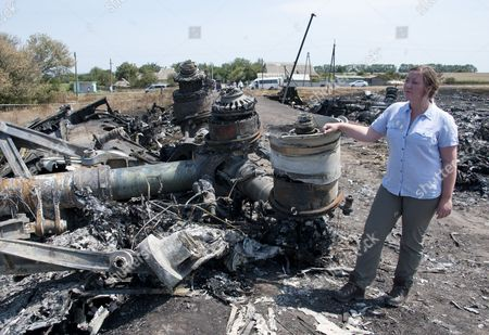 Ukraine: Abandoned And Unsecured With The Stench Of Death In The Air The Wreckage Of Flight Mh-17 Which Was Shot Down Over Ukraine 8 Days Ago. Pictured Here In Fields On The Edge Of The Village Of Grabovo Is The Burnt Remains Of The Main Fuselage Engines And Landing Gear And Reporter Rebecca Evans.
