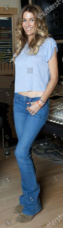 Stock Photo of Kirsty Bertarelli At The Metropolis Recording Studios In Chiswick London For Jane Fryer Interview. Picture Murray Sanders.