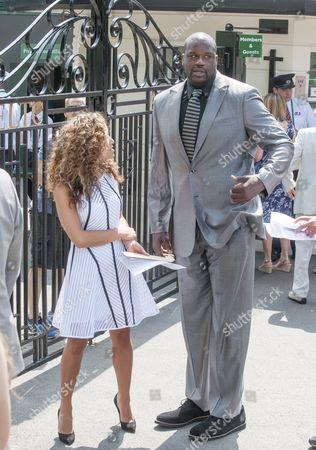 Editorial photo of Former Nba Player Shaquille O'neal 39 With Girlfriend Nicole 'hoopz' Alexander Arriving At The All England Tennis Club In Wimbledon To Watch Andrew Murray Defend His Title. Picture David Parker 23.6.14.