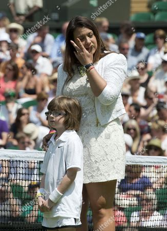 Editorial picture of Wimbledon Tennis Championships 2014; Marion Bartoli Sheds A Tear As She Returns To The Scene Of Her Victory In 2013 With Elle Robus-miller A Young Tennis Player From The Elena Baltacha Academy Of Tennis Credit Image: Graham Chadwick/daily Mail/solo S