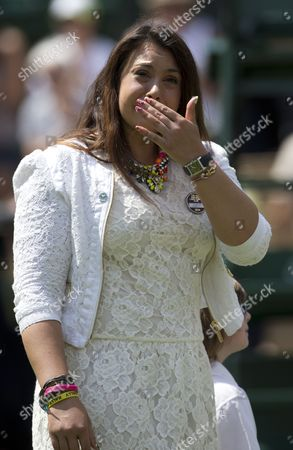 Wimbledon Tennis Championships 2014 Marion Bartoli Sheds A Tear As She Returns To The Scene Of Her Victory In 2013 With Elle Robus-miller A Young Tennis Player From The Elena Baltacha Academy Of Tennis  24/06/2014.