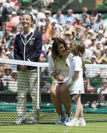 Stock Photo of Wimbledon Tennis Championships 2014 Marion Bartoli Sheds A Tear As She Returns To The Scene Of Her Victory In 2013 With Elle Robus-miller A Young Tennis Player From The Elena Baltacha Academy Of Tennis  24/06/2014.