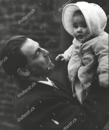Baron Edward Von Falz-fein Holding His Daughter Ludmilla Von Falz-fein Of Liechtenstein After Her Christening At The Savoy Chapel. *date Unknown - Dec 1952* Box 0606 13072015 00011a.jpg.