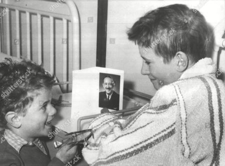 Brian Gibbons (l) Recipient Of The George Medal After Rescuing His Cousin During The Southall Plane Crash. A Vickers Viking Aircraft Crashed Into A Row Of Houses With The Loss Of Seven Lives. He Is Pictured With His Nephew Tommy (5) Box 0606 13072015 00321a.jpg.