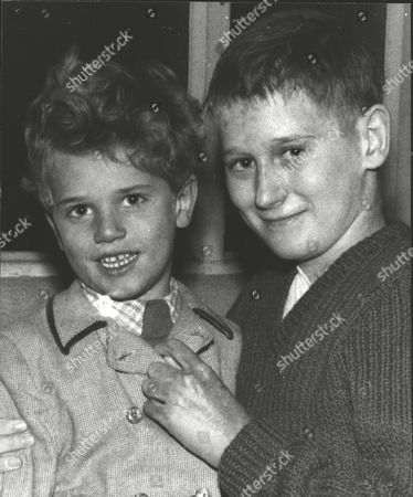 Brian Gibbons (l) Recipient Of The George Medal After Rescuing His Cousin During The Southall Plane Crash. A Vickers Viking Aircraft Crashed Into A Row Of Houses With The Loss Of Seven Lives. He Is Pictured With His Nephew Tommy (5). Box 0606 13072015 00318a.jpg.