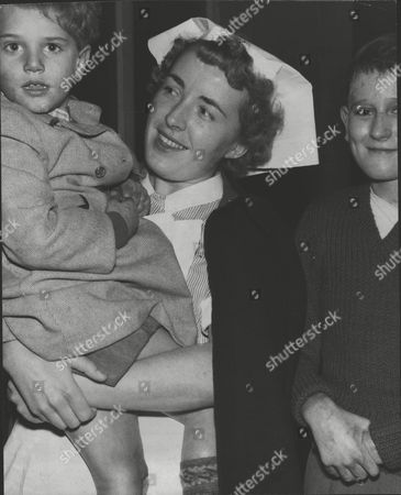 Brian Gibbons (l) Recipient Of The George Medal After Rescuing His Cousin During The Southall Plane Crash. A Vickers Viking Aircraft Crashed Into A Row Of Houses With The Loss Of Seven Lives. He Is Pictured With His Nephew Tommy (5) And Nurse Christina Elber. Box 0606 13072015 00324a.jpg.