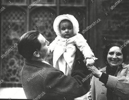Baron Edward Von Falz-fein Holding His Daughter Baroness Ludmilla Von Falz-fein Of Liechtenstein After Her Christening At The Savoy Chapel. Her Mother Was Formerly Miss Virginia Curtis-bennett. Box 0606 13072015 00481a.jpg.