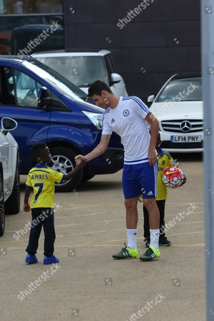 Stock Photo of Oscar dos Santos Emboaba Junior and Ramires' two young sons