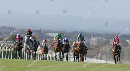 Stock Image of GLASGON Ridden by Miss S Brotherton (RED CAP BLACK& YELLOW) wins at Carlsile