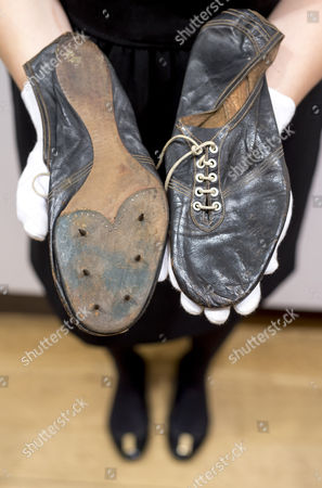 A pair of English Black Leather Running Shoes 1954, by Charles Law of G.T. Law and Son, Wimbledon Park, Surrey. - worn by Roger Bannister when he broke the record for the 4 minute mile, in 3 min 29.4 seconds on 6th May 1954 est. £30,000-50,000