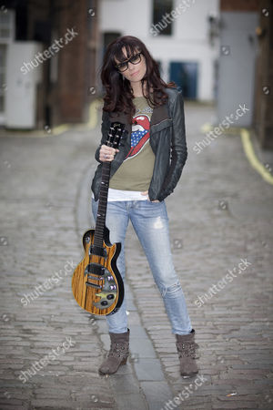 Stock Photo of Singer wongwriter Noush Skaugen who has over 1.2 Million followers on Twitter poses Gibson Guitar HQ in London with various Gibson Guitars