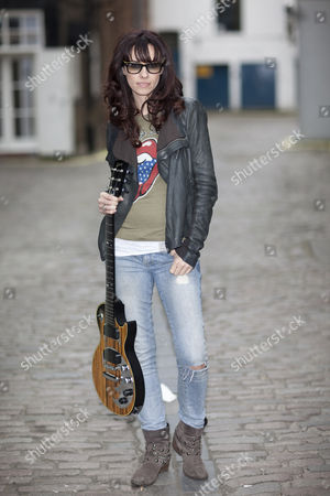 Stock Image of Singer wongwriter Noush Skaugen who has over 1.2 Million followers on Twitter poses Gibson Guitar HQ in London with various Gibson Guitars
