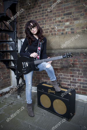 Singer wongwriter Noush Skaugen who has over 1.2 Million followers on Twitter poses Gibson Guitar HQ in London with various Gibson Guitars