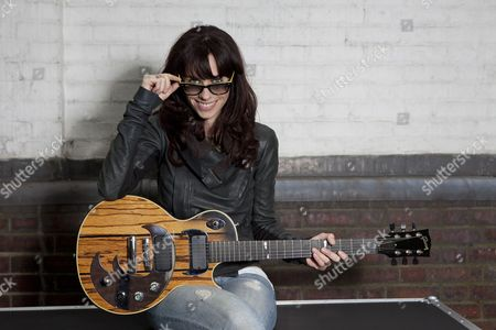 Stock Picture of Singer wongwriter Noush Skaugen who has over 1.2 Million followers on Twitter poses Gibson Guitar HQ in London with various Gibson Guitars