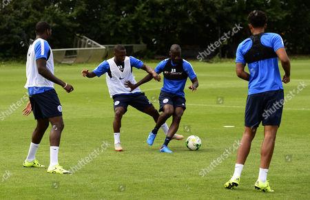 Junior Hoilett and Samba Diakite of QPR