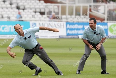 Nasser Hussain dives for a catch watched by colleague Ricky Ponting during a slip fielding demonstration for Sky TV before the start of play.