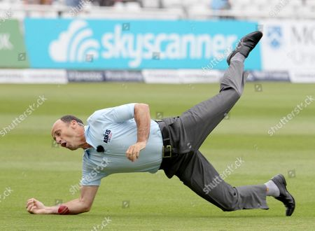 Nasser Hussain dives but drops a catch during a slip fielding demonstration for Sky TV before the start of play.