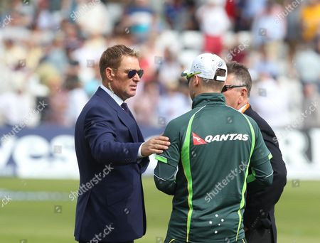 Stock Photo of Shane Ware (left) the former Australia player with Michael Clarke (back to camera) the Australia captain and head selector Rodney Marsh before play.