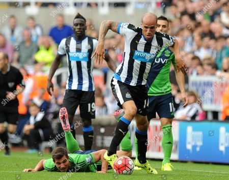 Gabriel Obertan of Newcastle United (right) gets past Cedric Soares of Southampton during the Barclays Premier League match between Newcastle United and Southampton played at St. James' Park, Newcastle upon Tyne