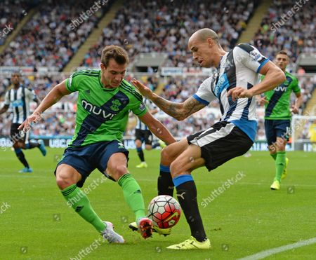 Gabriel Obertan of Newcastle United  (right) tries to get the ball past Cedric Soares of Southampton during the Barclays Premier League match between Newcastle United and Southampton played at St. James' Park, Newcastle upon Tyne