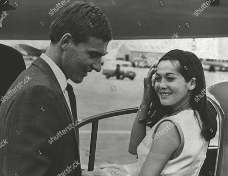 Nancy Kwan Actress With Her Husband Peter Pock At London Heathrow Airport. Box 0618 22072015 00426a.jpg.