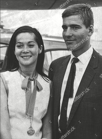Nancy Kwan Actress With Her Husband Peter Pock At London Heathrow Airport. Box 0618 22072015 00473a.jpg.
