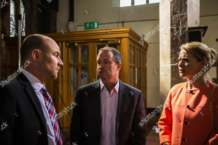 Stock Image of Tim Metcalfe [JOE DUTTINE] calls off the christening, for the sake of Faye and Miley's well being. Whilst he's breaking the news to the congregation, Josie Hodge [EVA McNULTY] and Grieg Hodge [STUART WOLFENDEN] approach Tim, suggesting it may be better if Miley were to live with him.