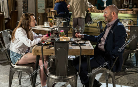 Liz takes Dan [ANDREW PAUL] and his daughter to the bistro for dinner. Leanne Tilsley [JANE DANSON] smiles at them through gritted teeth.