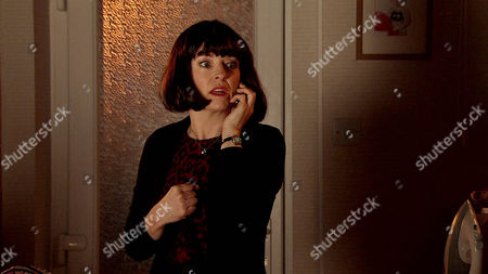 Stock Photo of Maddie [AMY KELLY] is perplexed to find Jenny Bradley [SALLY-ANN MATTHEW] at No.13 wearing a wig with her bags packed.