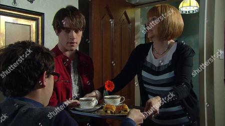 Val Pollard [CHARLIE HARDWICK] is puzzled over Finn Barton's {JOE GILL] attitude regarding Darren [DANNY HORN].