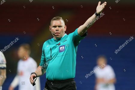 Referee Richard Clark during the Capital One first round cup match between Bolton Wanderers and Burton Albion played at the Macron Stadium, Bolton