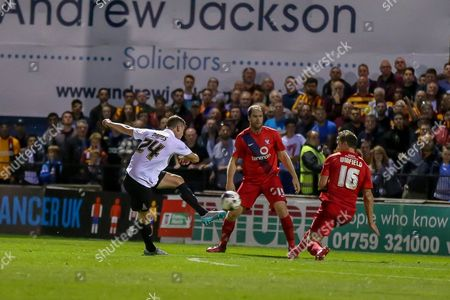 Stephen Davies gets a shot off during the Capital One Cup match between York City and Bradford City at Bootham Crescent, York