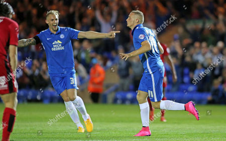 Marcus Maddison (right) of Peterborough United celebrates scoring the second goal with team-mate Jack Collison- Mandatory byline: Joe Dent/JMP