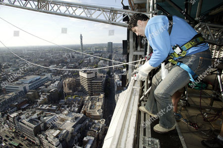 Steve Truglia preparing to abseil from the Centre Point building. He set a new World record, abseilling 100 metres in 8 seconds.