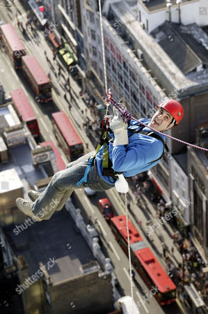 Steve Truglia abseiling from the Centre Point building. He set a new World record, abseilling 100 metres in 8 seconds.