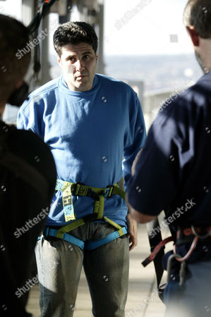 Steve Truglia preparing for the abseiling record attempt from the Centre Point building. He set a new World record, abseilling 100 metres in 8 seconds.