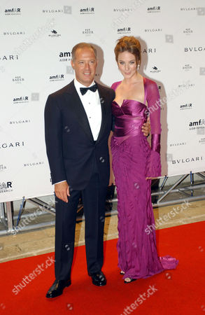 Francesco Trapani managing director of Bulgari with Lynn Collins attending the Amfar party.