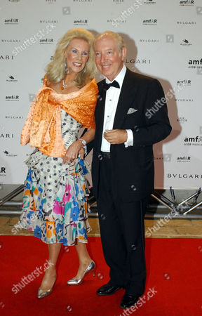 Stock Picture of Prince Carlo Giovanelli and Brigitte Bergen attending the Amfar Party.